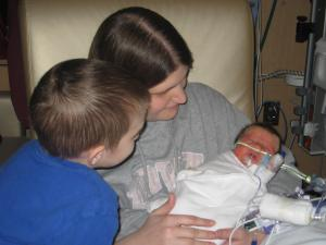 Amy holding Asher in NICU